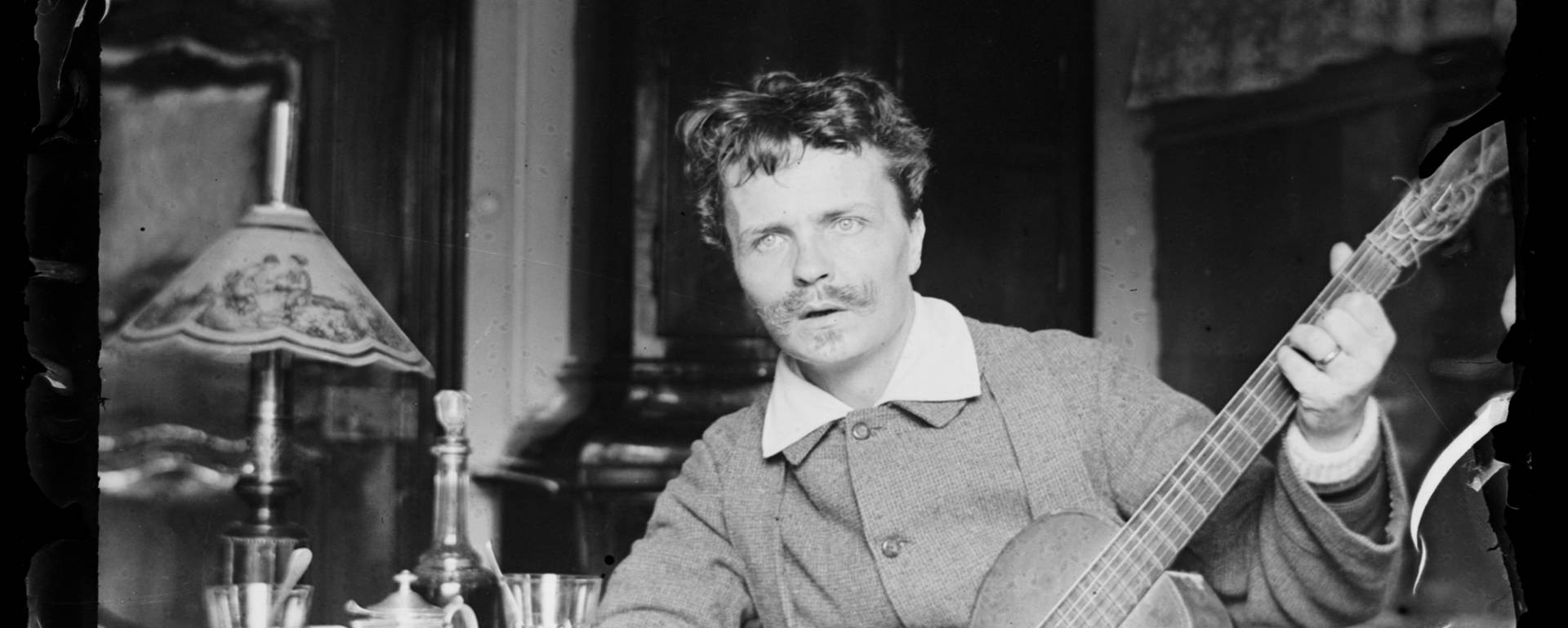 Strindberg with his guitar